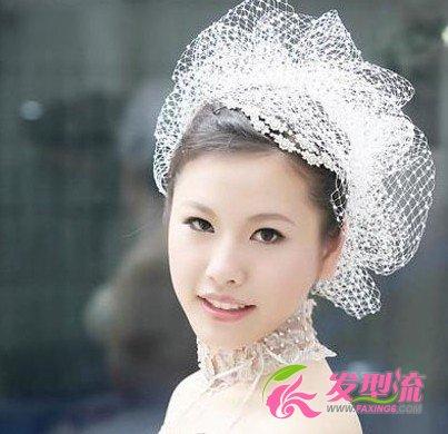 准新娘伊能静优雅发型 魅力青春的形象 →充满仙气的新娘发型图片