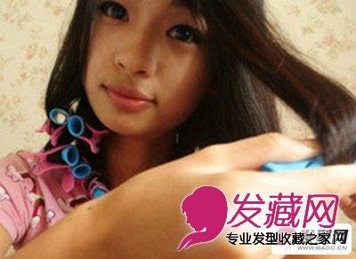 用卷发棒卷梨花头步骤八:卷到 刘海 处时,只需将刘海缠绕到卷发棒上一图片