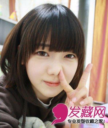 内扣的造型搭配碎剪刘海超显脸小,甜美呆萌的少女范儿.图片