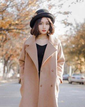 冬季戴帽子怎么配发型?这些美眉有新招